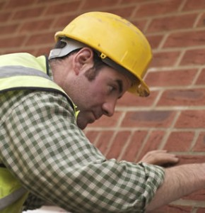 An image of an installer carrying out work on a house