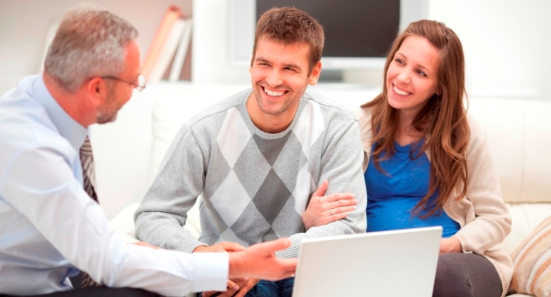 Homeowners happy with a sales presentation by a reliable tradesman