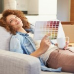 Woman on sofa: Homeowner choosing home improvement from colour range