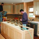 Tradesmen at work in a kitchen