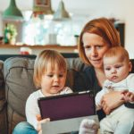 Mother and kids researching trusted and approved tradesmen